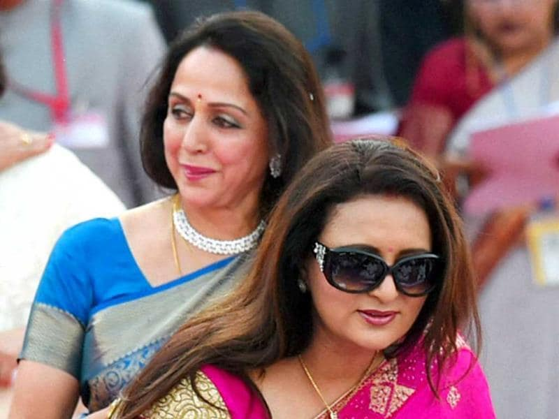 Actor-MP Hema Malini and actress Poonam Dhillon at the swearing-in ceremony of the NDA government at Rashtrapati Bhavan in New Delhi. (PTI Photo)