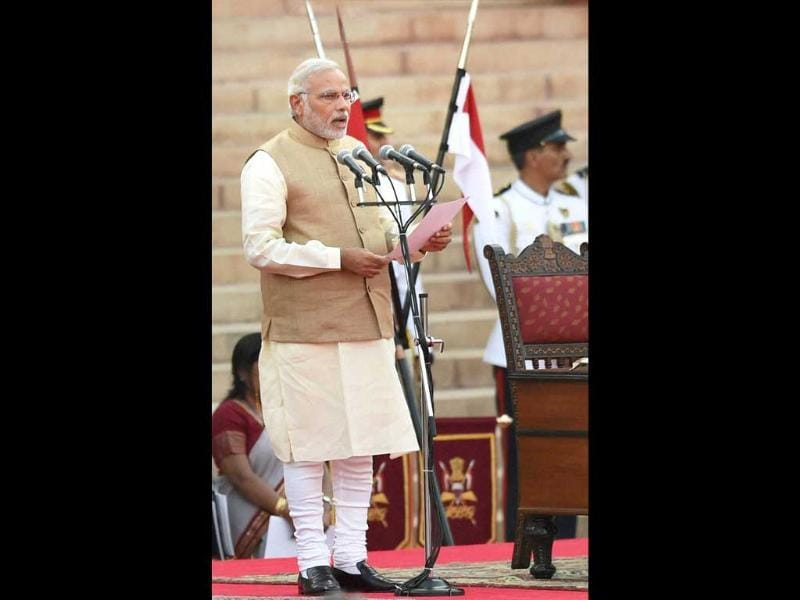 Narendra Modi takes oath as the 15th Prime Minister of India, at a ceremony at Rashtrapati Bhavan in New Delhi . (PTI photo)