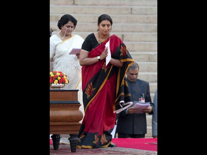 BJP's Smriti Irani greets the audience after she takes oath of office at the presidential palace in New Delhi. (AP Photo)