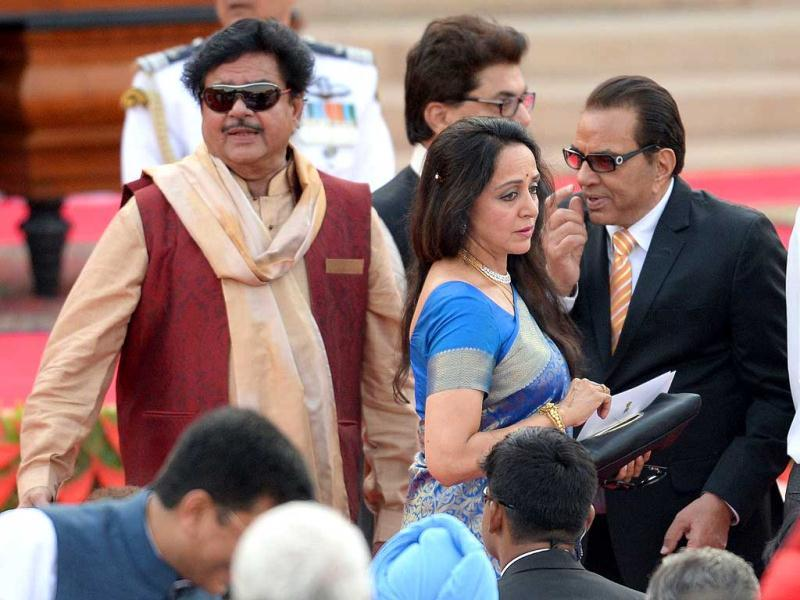 Bhartiya Janata Party leaders and Bollywood actors Shatrughan Sinha, Hema Malini and Dharmendra arrive to attend the swearing-in ceremony for new Indian Prime Minister Narendra Modi in New Delhi. (AFP)