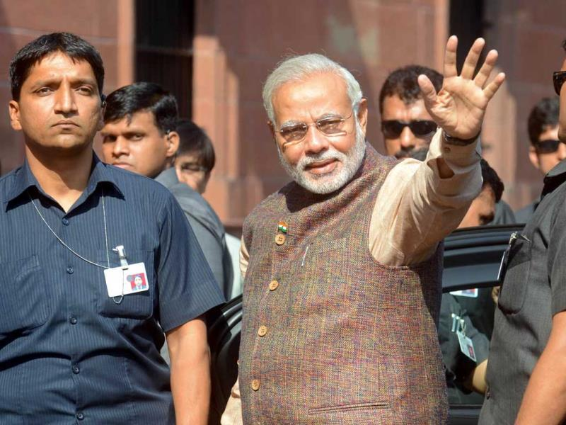 Prime Minister Narendra Modi gestures during his arrival at the Prime Minister's Office at South Block in New Delhi. (AFP Photo)