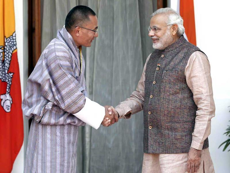 Prime Minister Narendra Modi shakes hands with his Bhutanese counterpart Tshering Tobgay in New Delhi. (Reuters Photo)