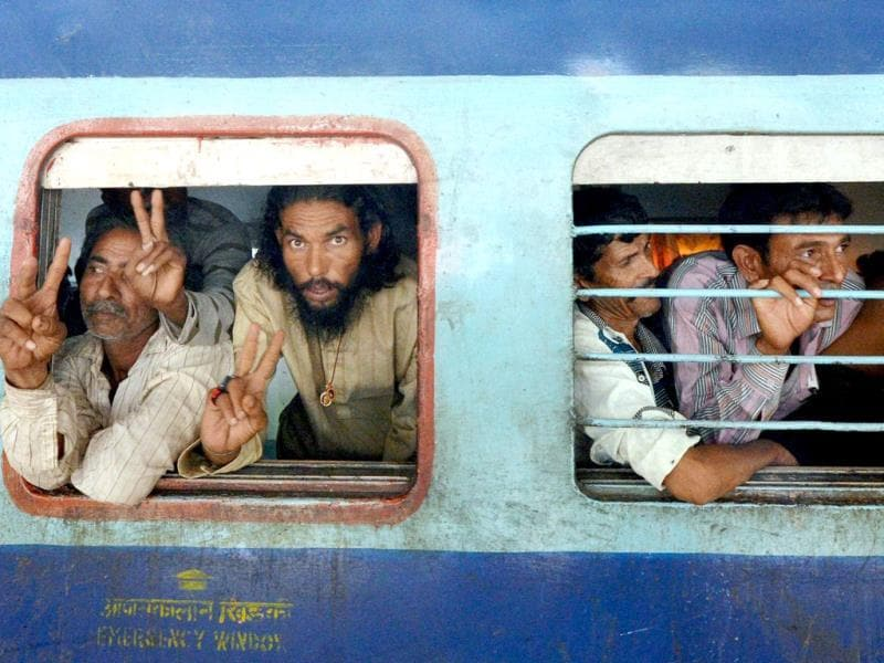 Indian fishermen released by Pakistan arrive by train at the Ahmedabad Railway Station. (PTI Photo)