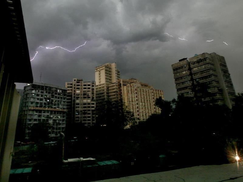 Lightning strikes over the buildings during an evening thunderstorm in New Delhi. (Photo by Raj K Raj/HT photo)