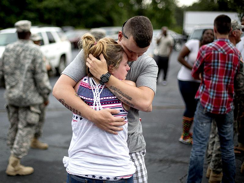 Spc. Wesley Freeman (R) embraces his girlfriend Christie McCarron as he says goodbye before roll call on the eve his unit, the Georgia National Guard 876th Vertical EN Company, deploys to Afghanistan. (AP Photo)