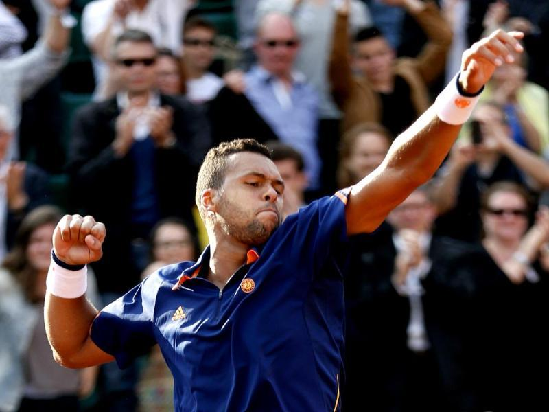 Jo-Wilfried Tsonga of France celebrates his victory over Jerzy Janowicz of Poland in their men's singles match at the French Open at Roland Garros in Paris. (Reuters Photo)