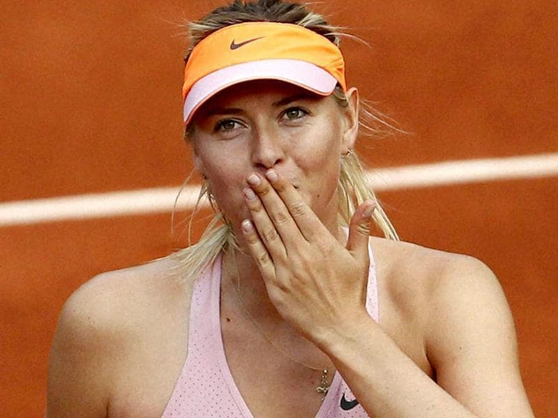 Russia's Maria Sharapova blows a kiss to spectators after winning her third round match of the French Open against Argentina's Paula Ormaechea at Roland Garros in Paris. (AP Photo)