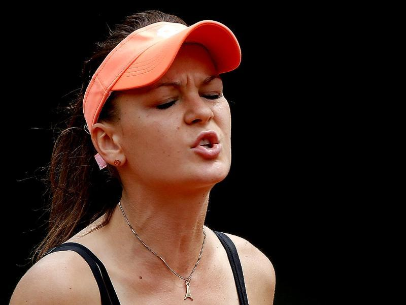 Poland's Agnieszka Radwanska reacts as she plays Croatia's Ajla Tomljanovic during their third round match of the French Open at Roland Garros in Paris. (AP Photo)