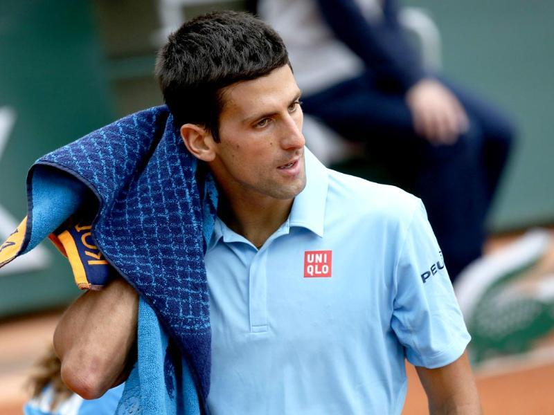 Serbia's Novak Djokovic gestures during his French Open third round match against Croatia's Marin Cilic at Roland Garros in Paris. (AFP Photo)