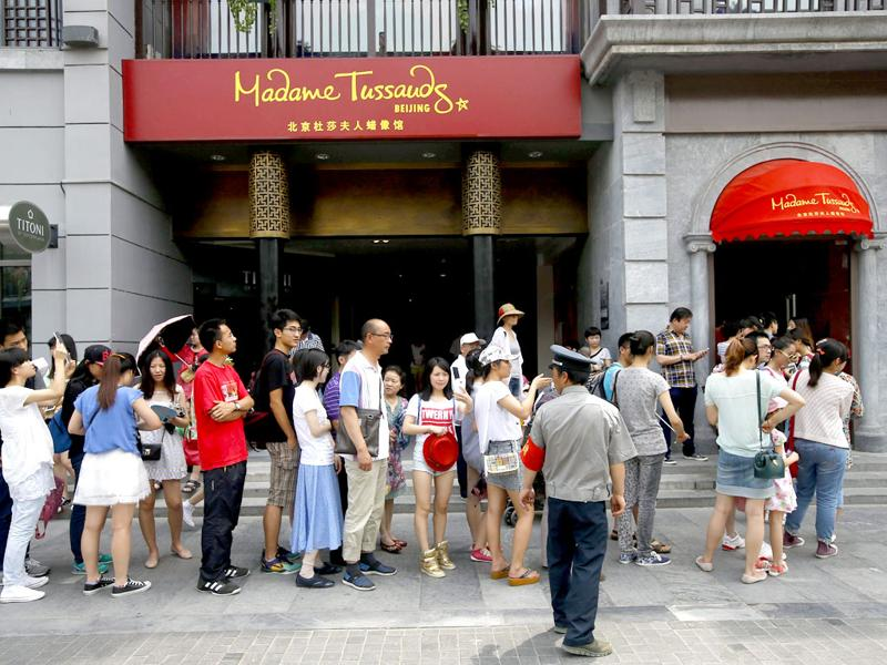 Visitors queue to enter the Madame Tussauds museum in Beijing, China. (EPA Photo)