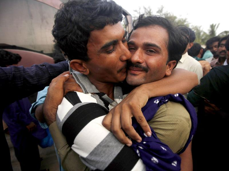 A Pakistani fisherman, who was released from an Indian jail, hugs his relative as he arrives at a Karachi fish harbour. (Reuters Photo)