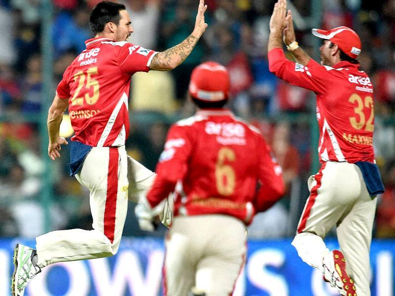 Kings XI Punjab's Mitchell Johnson celebrates the wicket of Robin Uthappa during their IPL 7 final match at the M Chinnaswamy stadium, in Bengaluru. (PTI Photo)