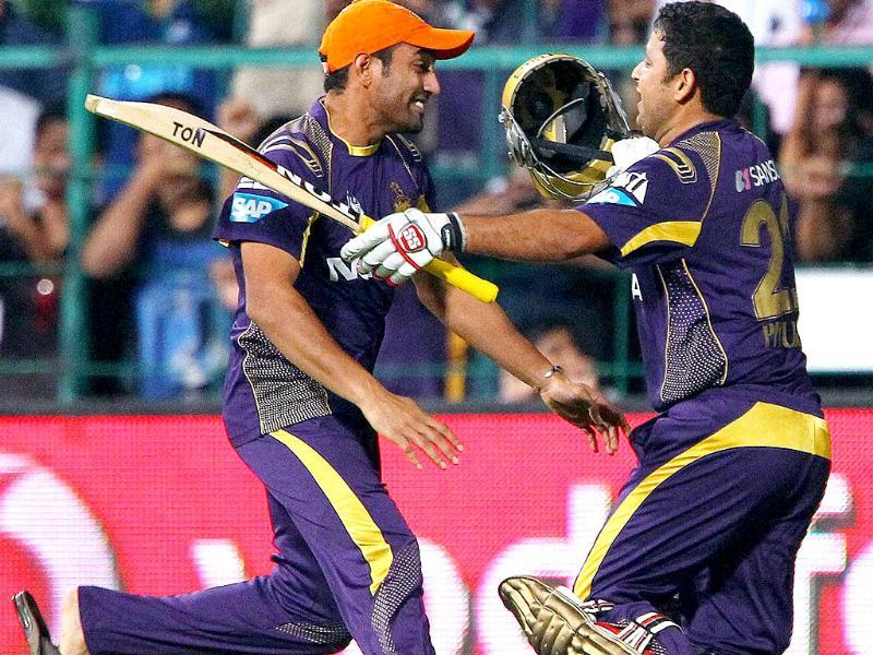 Robin Uthappa of the Kolkata Knight Riders and Piyush Chawla celebrate the win in the final match of IPL 7 against Kings Xi Punjab in Bengaluru. (PTI Photo)