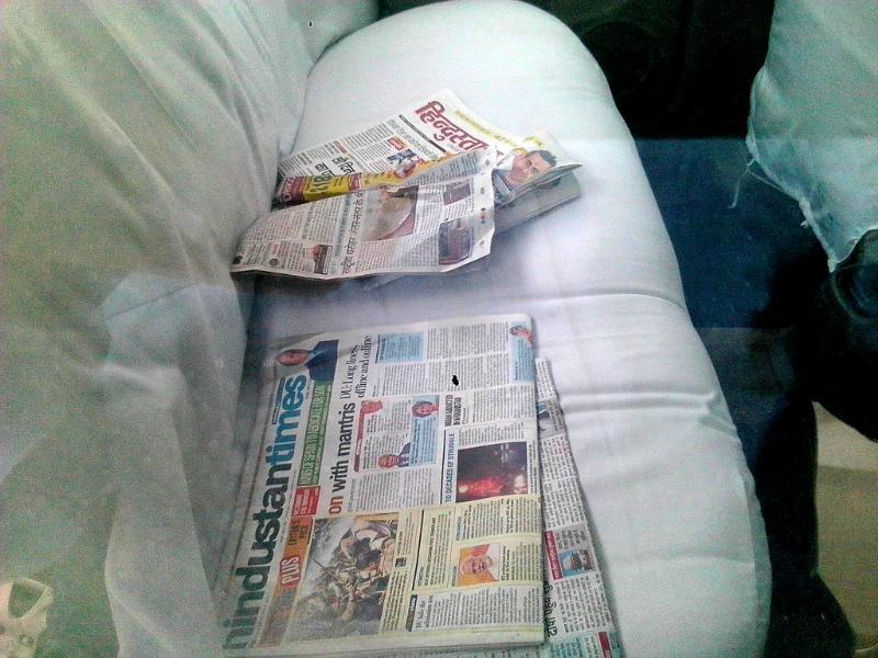 Copies of newspapers lie in the backseat of the car in which Gopinath Munde was travelling. (Sonu Mehta/HT Photo)