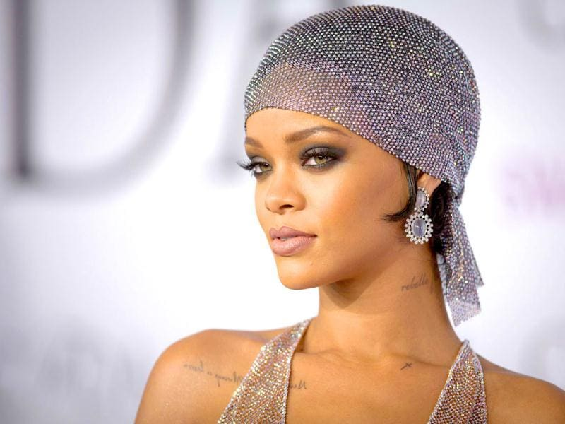 Rihanna, 26, looked breathtaking as she hit the Big Apple for the colorful carpet at the CDFA awards on June 2 in a sequin dress and head scarf. She looked stunning with a super smokey eye and nude lip. Did you love her look? We want to talk about her completely sheer dress anyway! A closer look at RiRi's look in these photos. (Photos: AFP, Reuters)