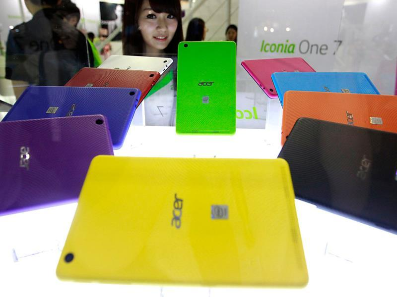 Acer's Iconia One 7 tablets are displayed at the Acer booth during the 2014 Computex exhibition at the TWTC Nangang exhibition hall in Taipei. Photo: Reuters/Pichi Chuang