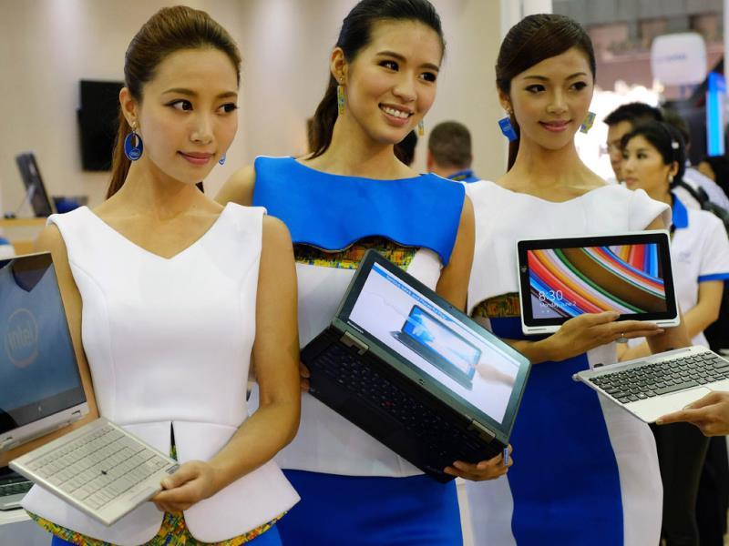Models display the latest products during the Computex tech show in Taipei. Photo: AFP / Sam Yeh
