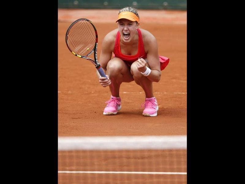 Eugenie Bouchard of Canada celebrates after beating Carla Suarez Navarro of Spain during their quarter final match for the French Open tennis tournament at Roland Garros in Paris, France (EPA Photo)