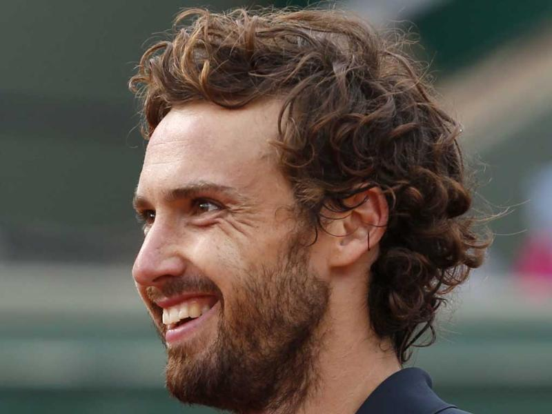 Latvia's Ernests Gulbis smiles during the quarter-final match of the French Open against Tomas Berdych of the Czech Republic at Roland Garros in Paris. (AP Photo)