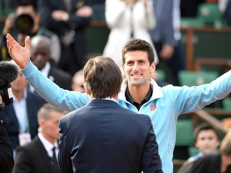 Novak Djokovic of Serbia celebrates his straight sets victory over Milos Raonic of Canada in their quarter-final match during the French Open at Roland Garros in Paris. (EPA Photo)