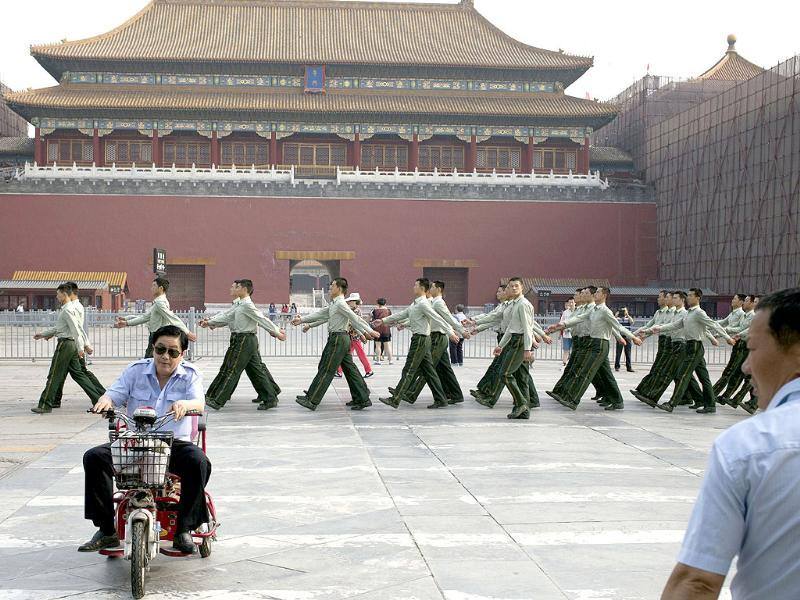 Chinese paramilitary policemen march in front of the entrance to the Forbidden City near Tiananmen Square in Beijing. Authorities in Beijing blanketed the city center with heavy security on the 25th anniversary of the bloody military suppression of pro-democracy protests centered on Tiananmen Square. (AP Photo)