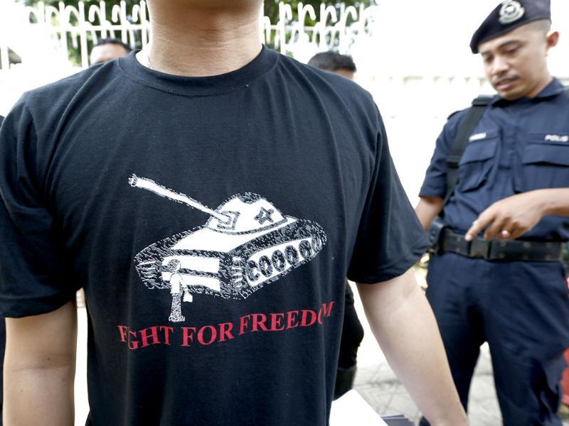 A protester wears a T-shirt with a tank during a protest in front of the Chinese Embassy in Kuala Lumpur, Malaysia. The protest was held to commemorate the 25th anniversary of the Tiananmen Square tragedy where China's military cracked down on pro-democracy protesters in 1989. (AP Photo)