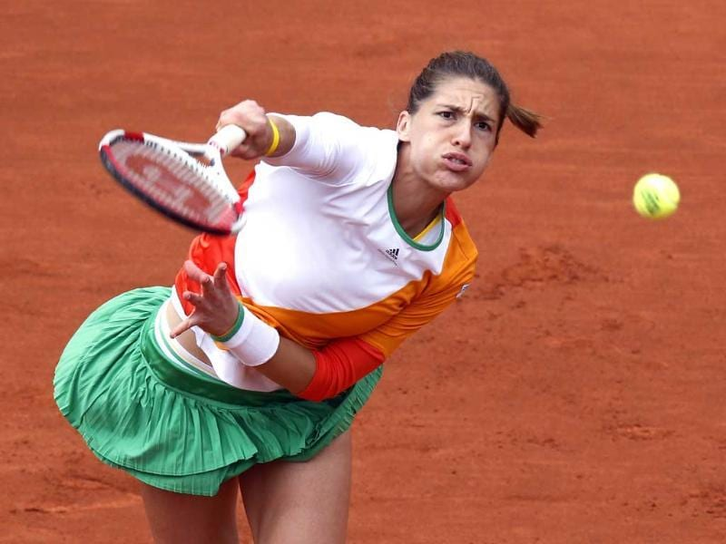 Germany's Andrea Petkovic serves to Italy's Sara Errani during their French Open quarter-final match at the Roland Garros stadium in Paris. (AFP Photo)