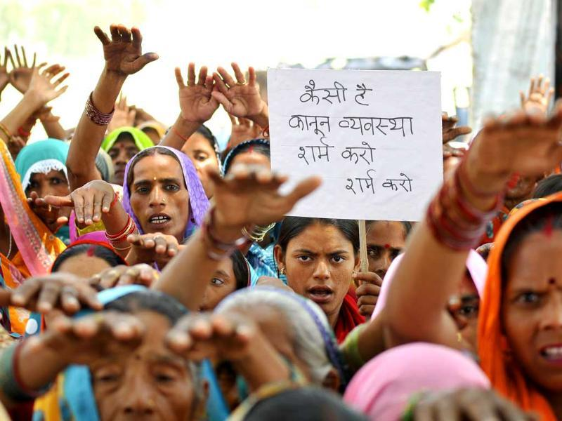 Women from villages take out a peaceful protest march to seek justice in the gangrape and murder of two minor girls in Badaun, Uttar Pradesh. (Burhaan Kinu/HT Photo)