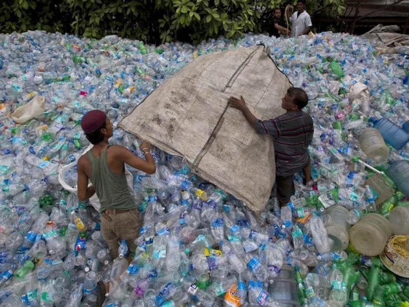 Workers empty a sack of plastic bottles at a recycling workshop in Mumbai. According to the United Nations Environment Programme website, World Environment Day is celebrated annually on June 5 to raise global awareness and motivate action for environmental protection. (Reuters)