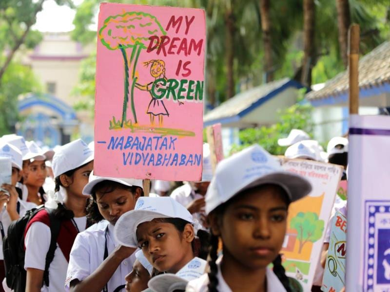 Students hold banners during an awareness rally 'Save the Environment' by the Bengal Government during the 'World Environment Day' in Kolkata. The World Environment Day is observed annually on 05 June, the theme for this year focuses on 'Small Islands and Climate Change'. Banner reading 'My dream is green'. (EPA photo)