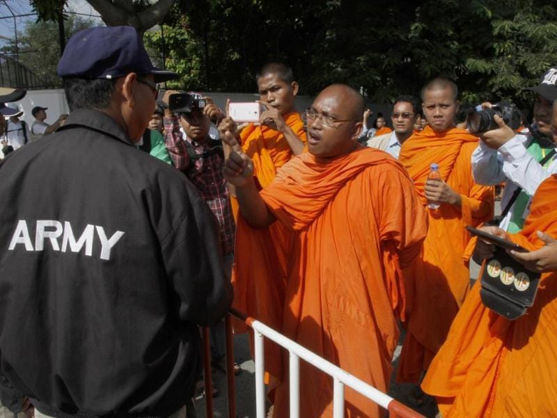 A Buddhist monk argues with a Cambodian security guard as they were blocked to reach National Assembly during a rally to mark World Environment Day, in Phnom Penh, Cambodia. Environmental activists tried in vain to submit petitions to urge the government to protect the country's environment. (AP Photo)