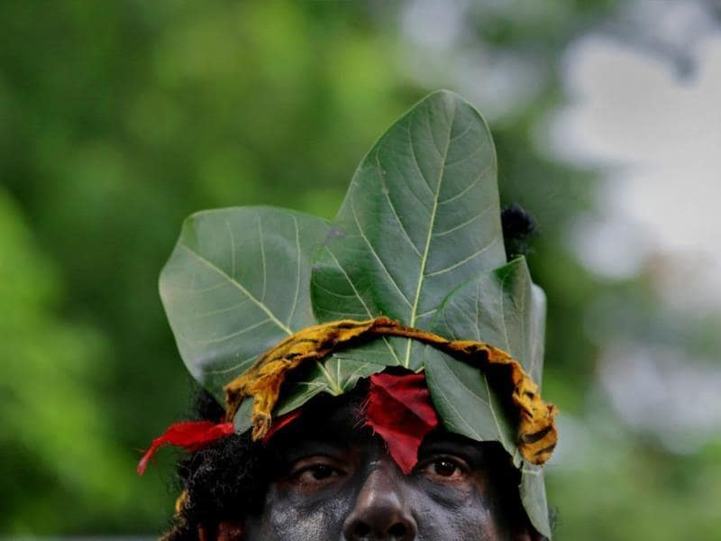 A man dressed as a tree during an awareness rally for the World Environment Day in Kolkata. The World Environment Day is observed annually on 05 June, the theme for this year focuses on 'Small Islands and Climate Change'. (EPA photo)