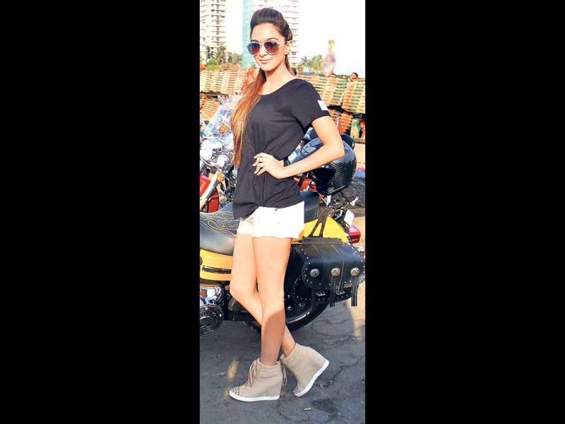 Newbie actor Kiara Advani looked 'biker' chic in a black T-shirt, teamed up with a pair of hot pants.