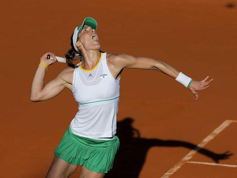 Germany's Andrea Petkovic serves during her semi-final match at the French Open against Romania's Simona Halep at Roland Garros stadium, in Paris. (AP Photo)