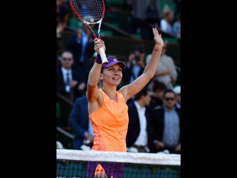 Simona Halep of Romania celebrates her win over Andrea Petkovic of Germany in their semi-final match at the French Open at Roland Garros in Paris. (EPA Photo)