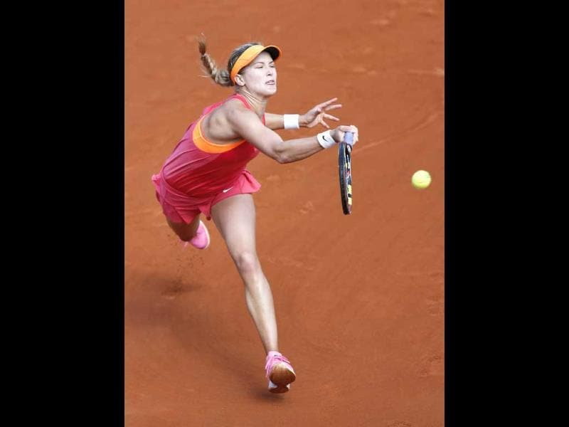 Eugenie Bouchard of Canada returns to Maria Sharapova of Russia in their semi-final match at the French Open at Roland Garros in Paris. (EPA Photo)
