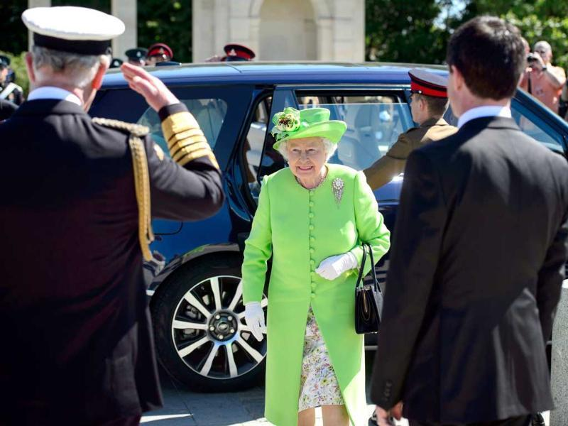 Britain's Queen Elizabeth II arrives for a British D-Day commemoration ceremony in Bayeux cemetery, northern France on Friday. World leaders and veterans gathered by the beaches of Normandy on Friday to mark the 70th anniversary of World War Two's D-Day landings. (AP Photo)