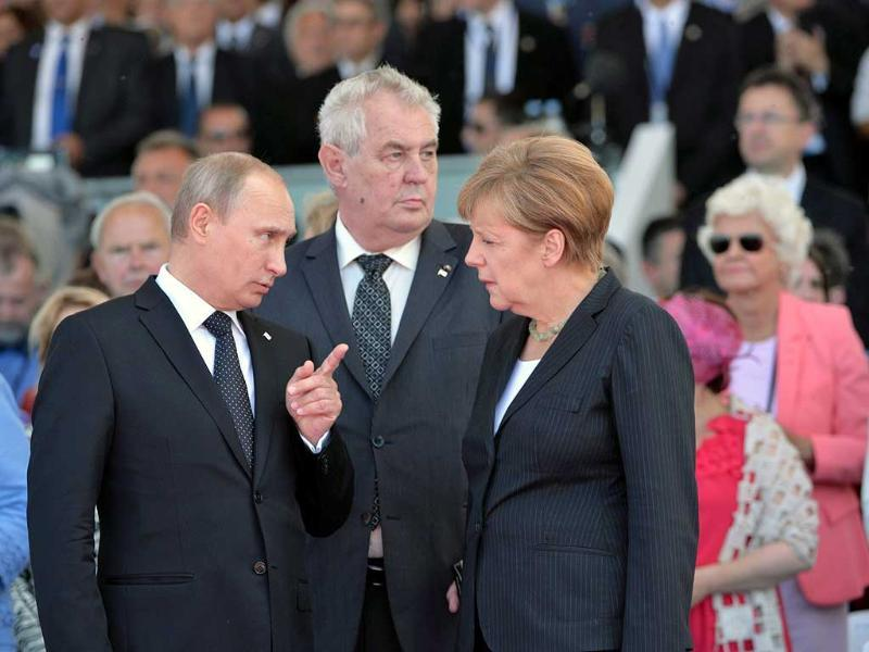 Russian President Vladimir Putin (left) chats with German Chancellor Angela Merkel (right) and Czech President Milos Zeman (centre) during the 70th anniversary of the D-Day landings, on Sword beach, Ouistreham, Normandy. More than 130,000 allied Troops landed on the beaches of Normandy on 06 June 1944. The invasion established a crucial second front in the Liberation of Europe from Nazi occupation, ultimately leading to victory for Allied Forces in 1945. EPA