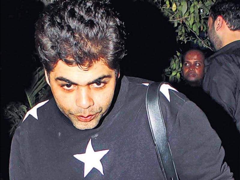 No, we didn't catch Karan Johar readying for a sprint. The film-maker was just taking a leap outside a Bandra nightclub. (HT Photo/ Yogen Shah)