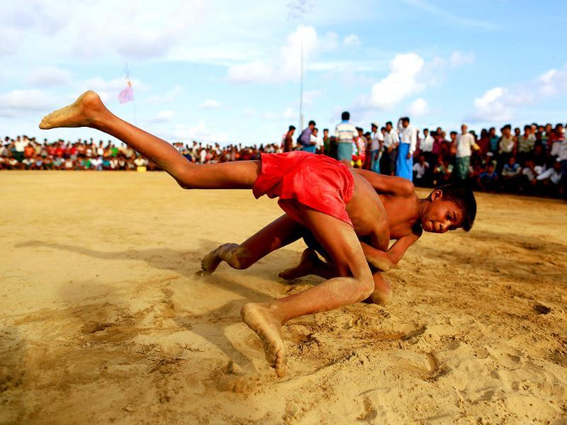 Rohingya Muslim boys fight as part of a traditional wrestling festival at Kyaukpannu village in Maungdaw, northern Rakhine. (Reuters Photo)
