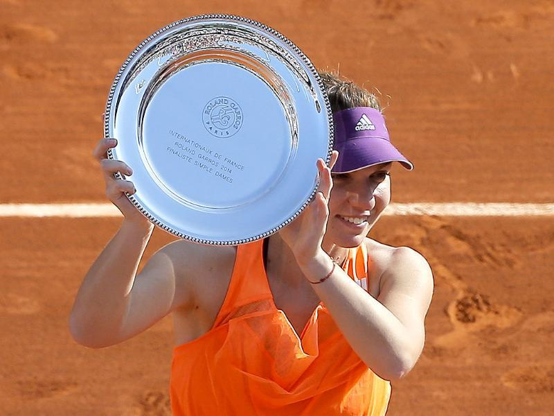 Romania's Simona Halep holds her trophy after losing to Russia's Maria Sharapova in the women's final of the French Open at Roland Garros, in Paris. (AP Photo)