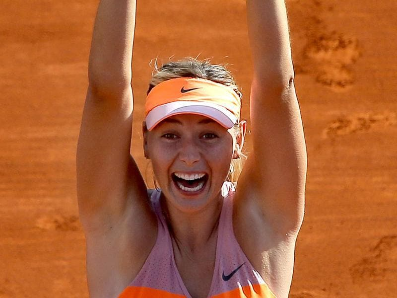 Russia's Maria Sharapova holds her trophy after winning the women's final match of the French Open against Romania's Simona Halep at Roland Garros in Paris. (AP Photo)