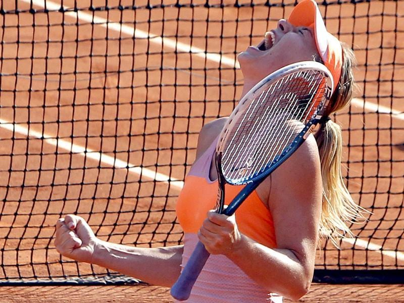 Russia's Maria Sharapova reacts after defeating Romania's Simona Halep in their final match of the French Open at Roland Garros in Paris. (AP Photo)