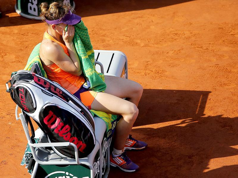 Romania's Simona Halep sits on her bench after Russia's Maria Sharapova won the final of the French Open at Roland Garros stadium. (AP Photo)