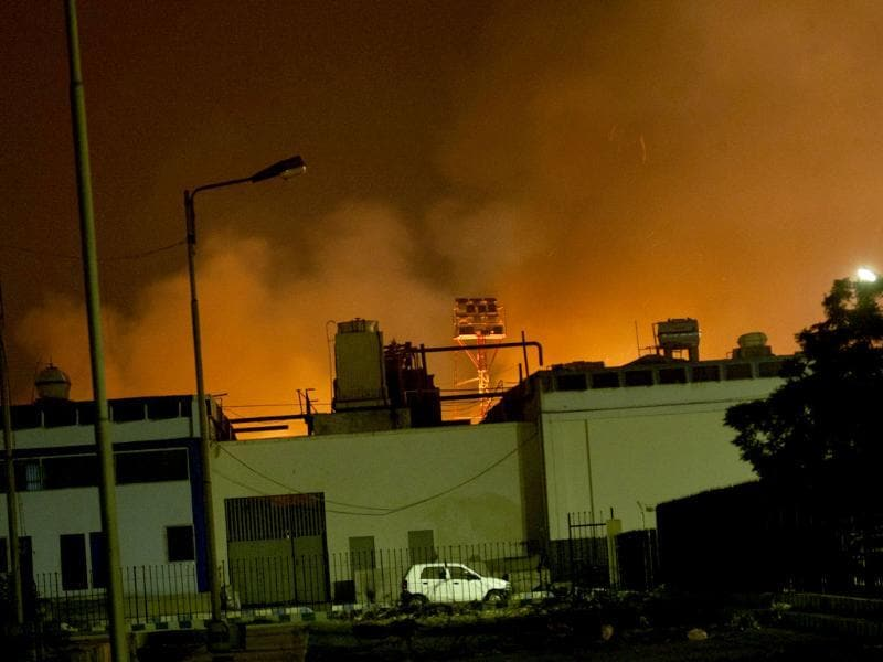 Fire illuminates the sky above Karachi airport terminal where security forces are fighting with attackers Pakistani security troops rushing to Karach in Pakistan. (AP Photo/Shakil Adil)