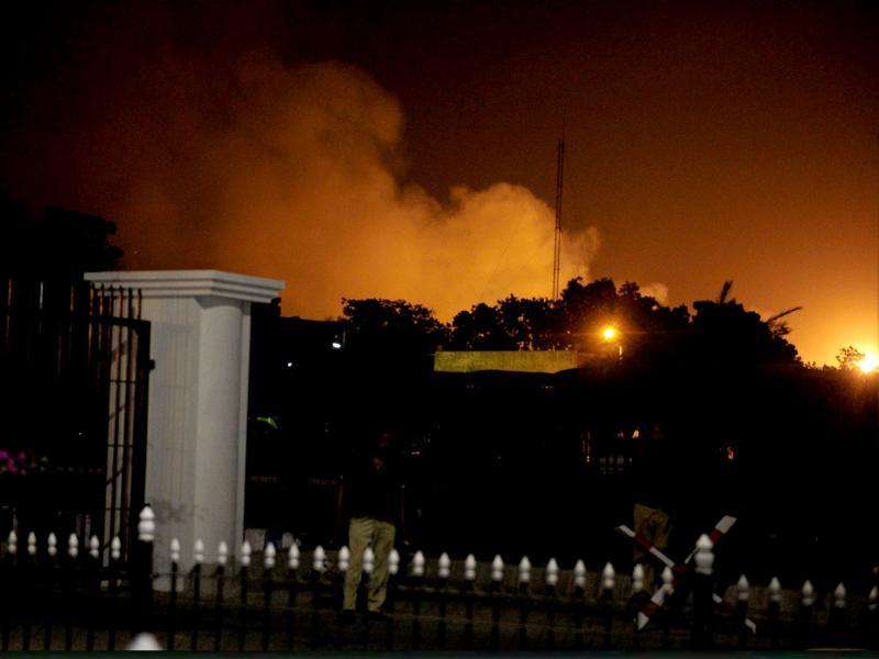 Smoke raises from the burning site of Jinnah International Airport after an assault in Karachi on late. (AFP photo)