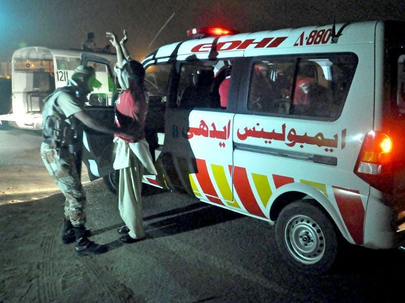 Pakistani Rangers check ambulance staff at the boundry wall after suspected militants attacked Jinnah International Airport in Karachi. (EPA)