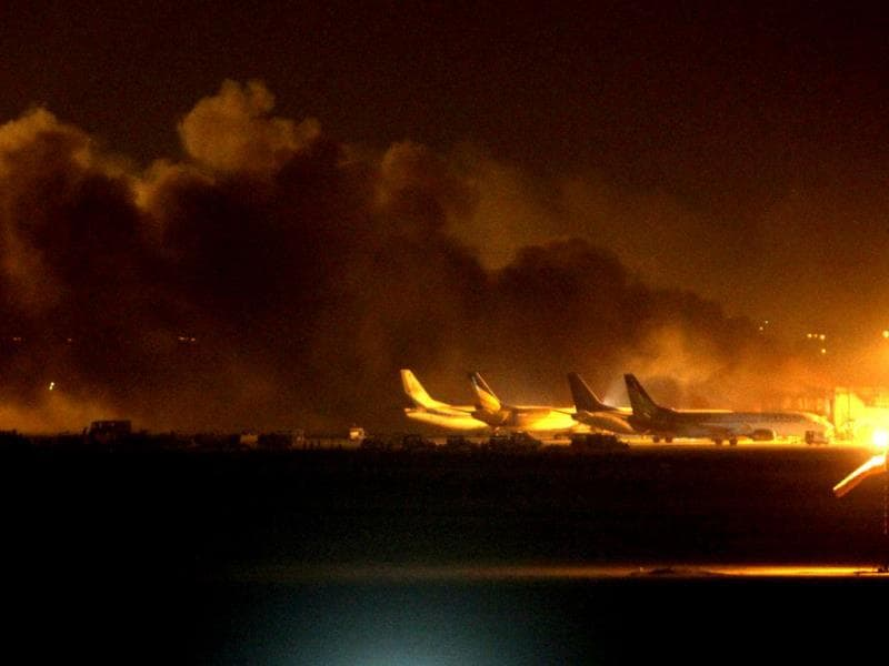 File photo: Fire illuminates the sky above the Jinnah International Airport in Karachi which was under attack recently by the Pakistani Taliban. (AP Photo)
