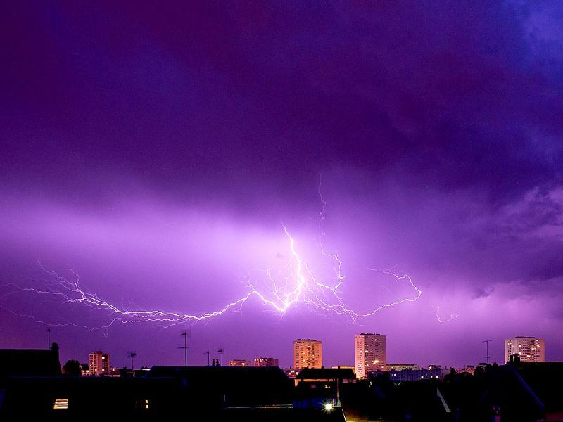 A lightning strikes during a thunderstorm over the city of Tours, central France. (AFP photo)