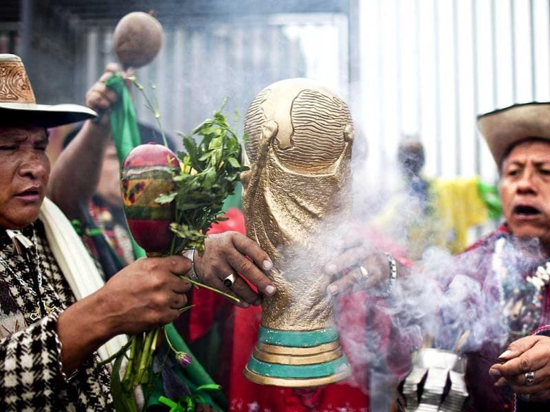 A shaman blesses the World Cup host nation Brazil and wishes good luck to key players. (Reuters photo)